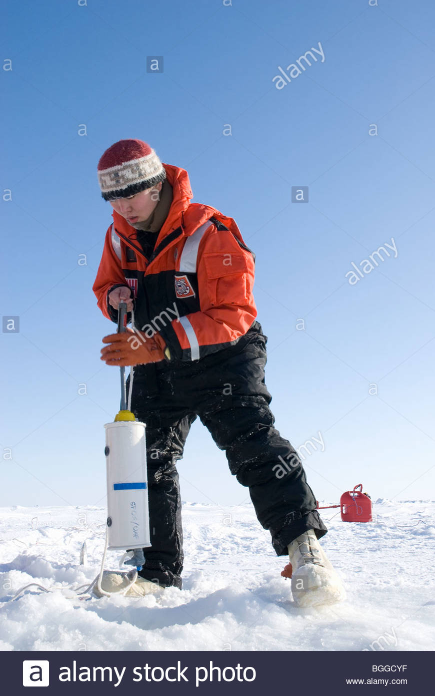 Alaska, Bering Sea. Scientists studying ice condiitons and the changing ecosystem due to global warming. A scientist - Stock Image