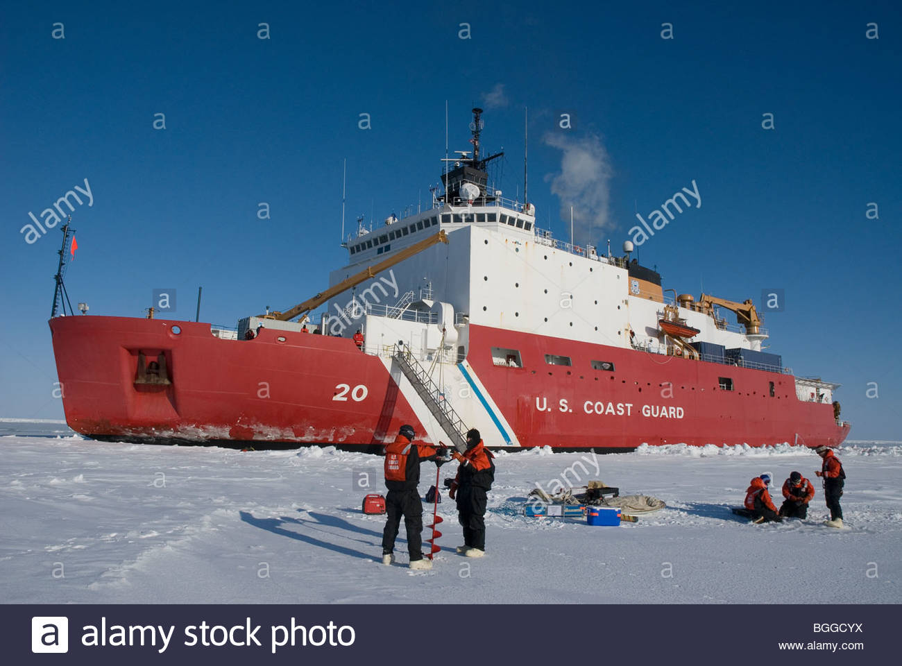 Alaska, Bering Sea. Scientents disembark from a US Coast Guard icebreaker to perform ice-coring tests on the pack - Stock Image