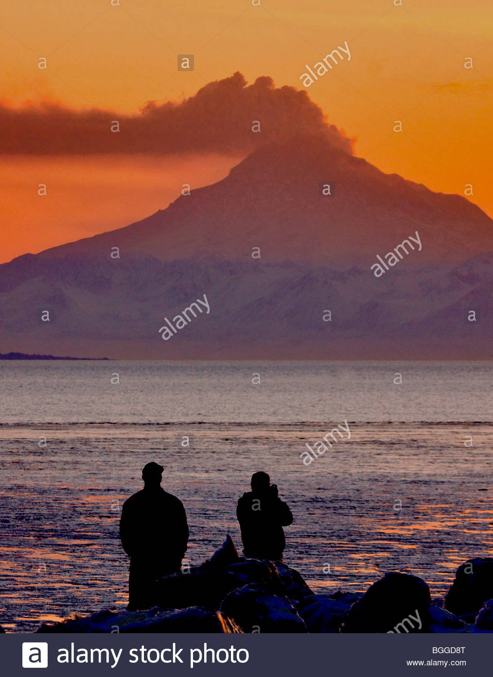 Alaska. Mt Redoubt volcano emitting steam with some ash, as viewed at sunset from Kenai visitors. Stock Photo