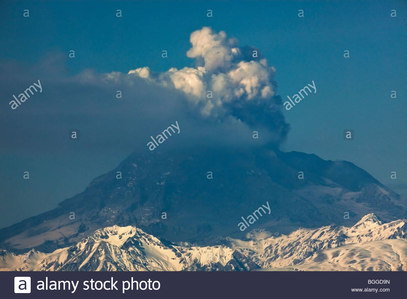 Alaska. Mt. Redoubt emitting steam and ash as viewed from Nikiski. Stock Photo