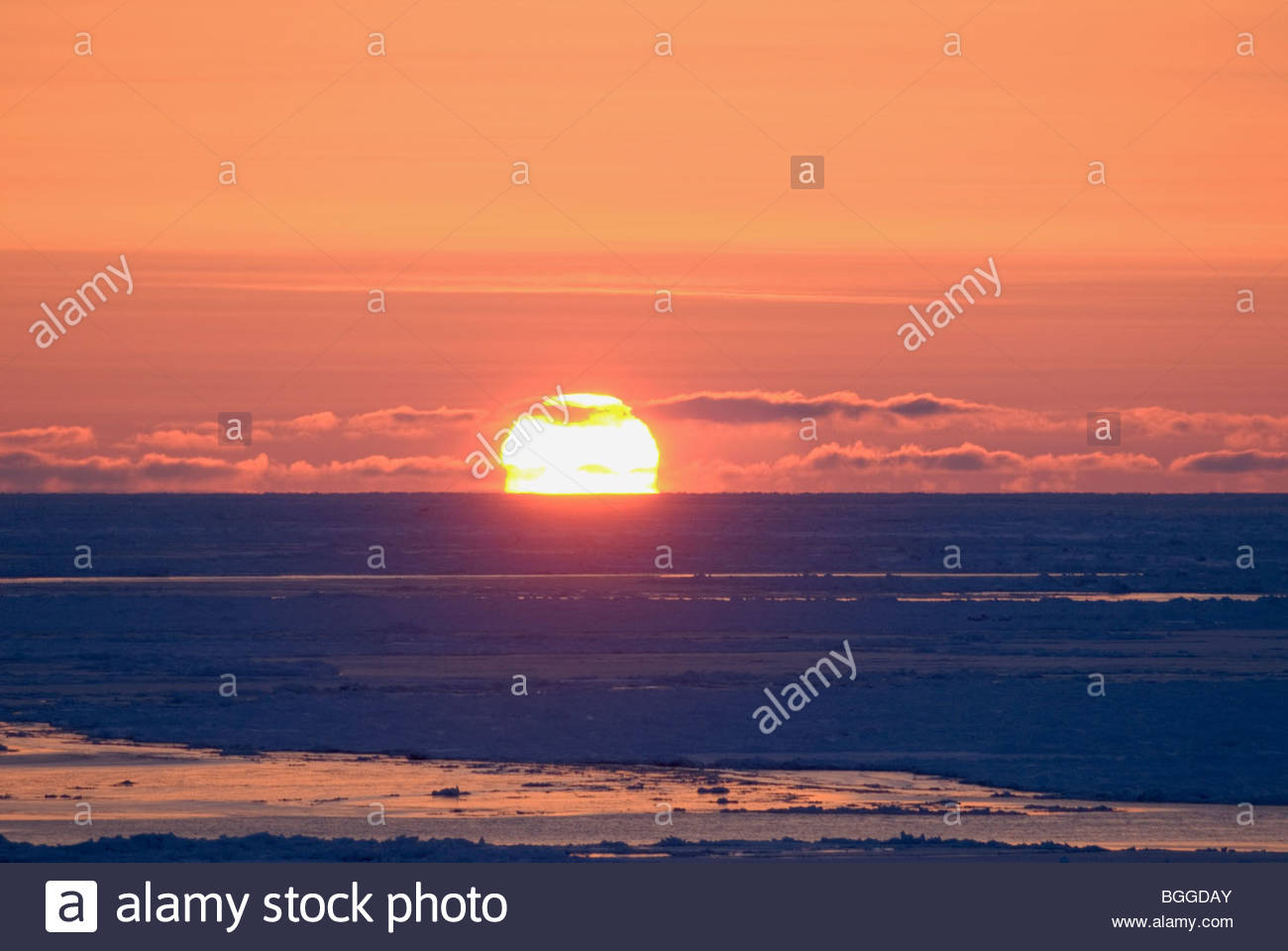 Alaska, Bering Sea. Sunset over the pack ice. Refraction Distortion. - Stock Image