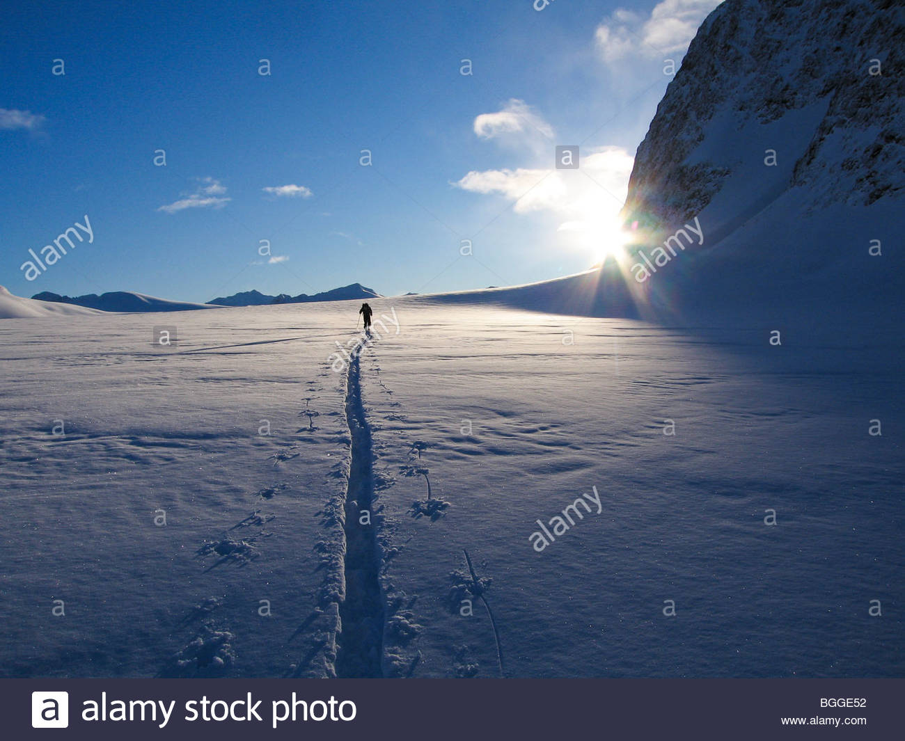Alaska, Chugach State Park, Eklutna Glacier. A climber crosses the Eklutna Glacier to approach Peril Peak. - Stock Image