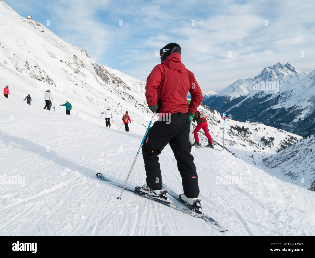 St Anton am Arlberg, Tyrol, Austria, Europe. Skier in red jacket on snow covered ski slopes in the Austrian Alps Stock Photo