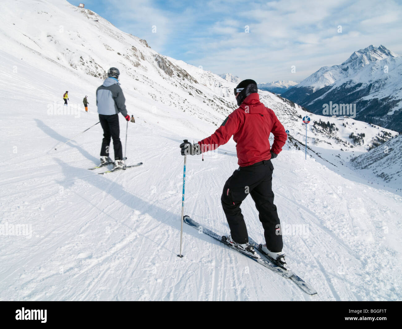 St Anton am Arlberg, Tyrol, Austria, Europe. Skier in red jacket on snow covered ski slopes in the Austrian Alps. Stock Photo