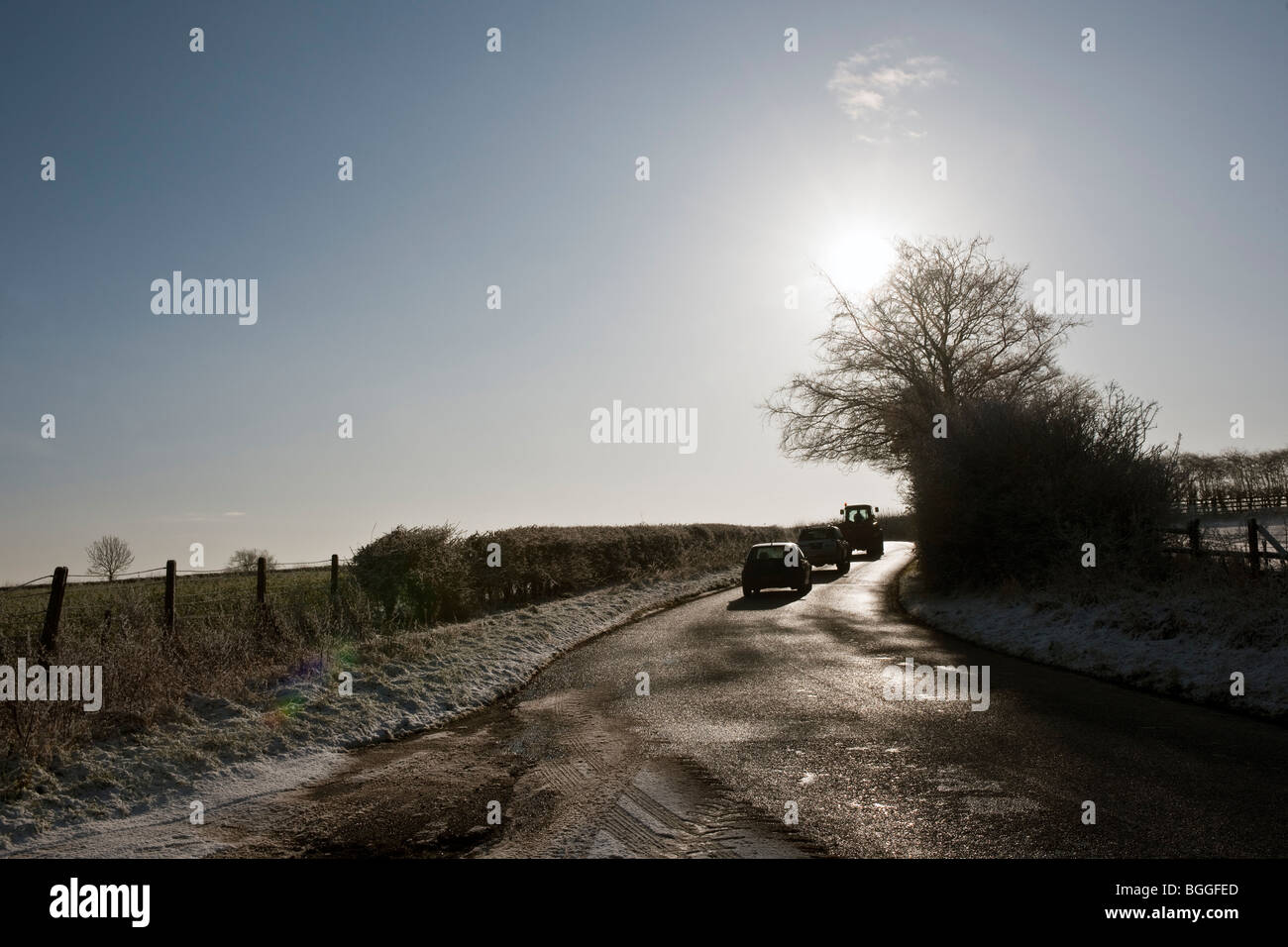 Cars traveling on road in ice and snow - Stock Image