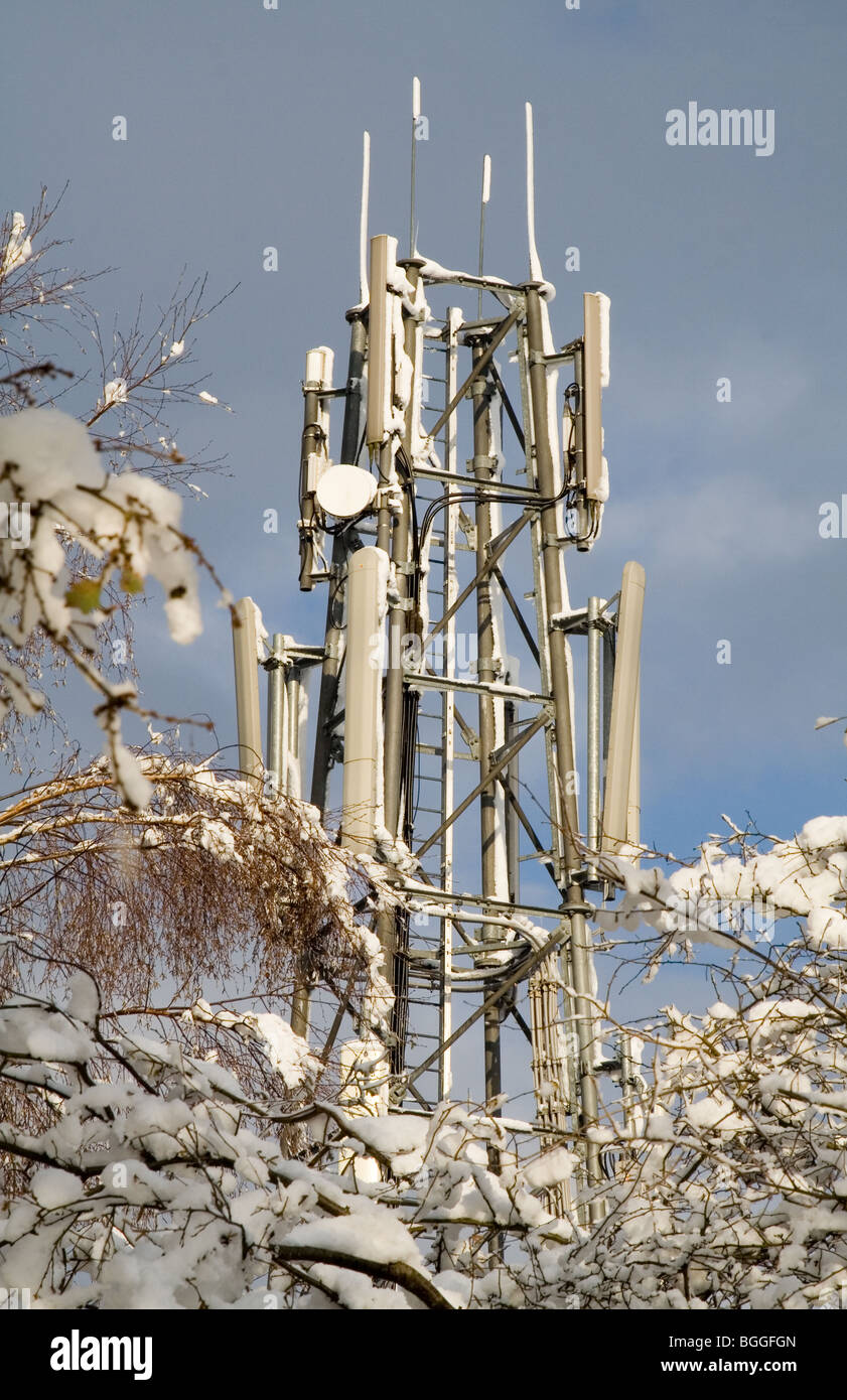 A mobile telephone mast with snow - Stock Image