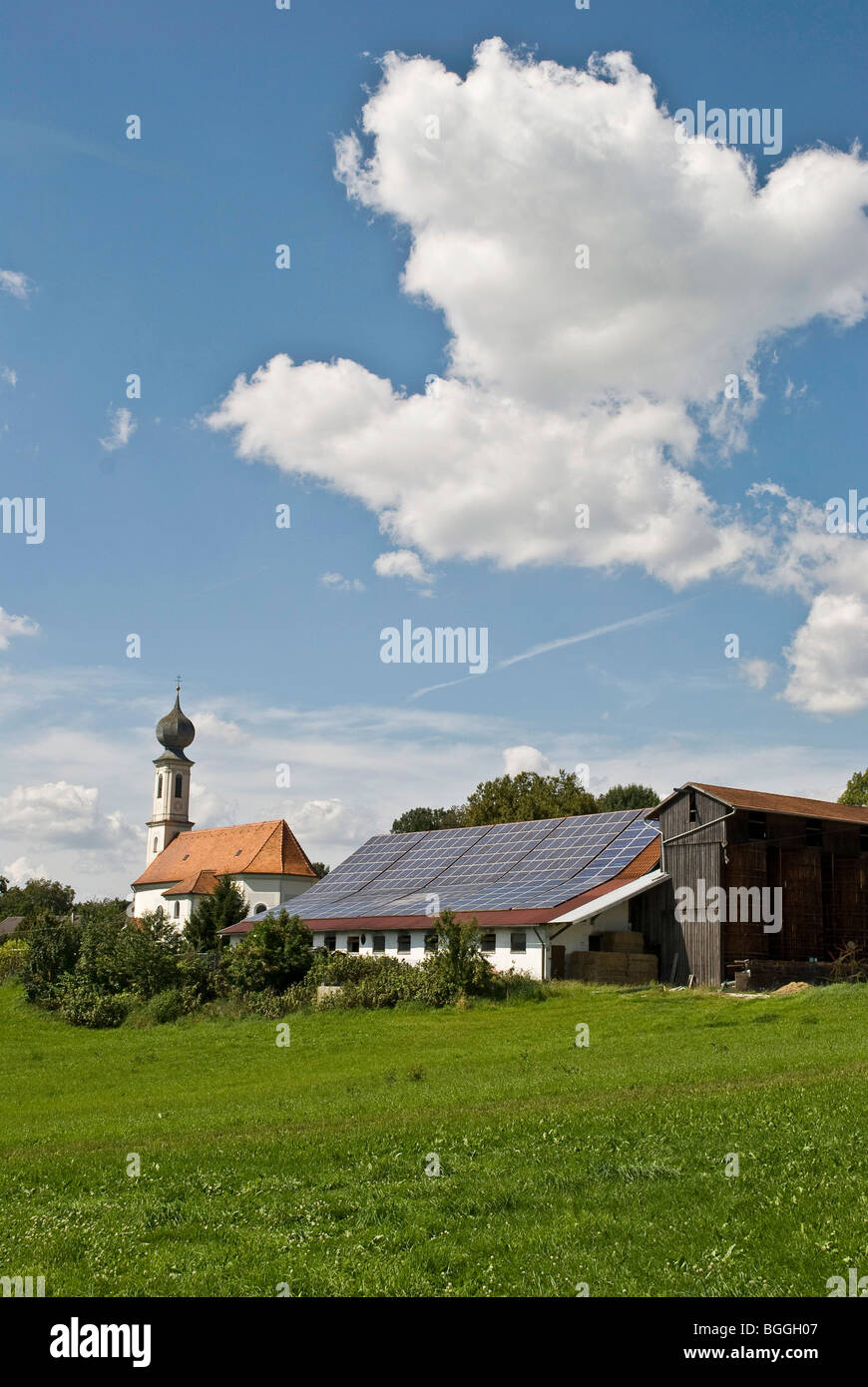Solar system on an agricultural building in Bavaria, Germany - Stock Image
