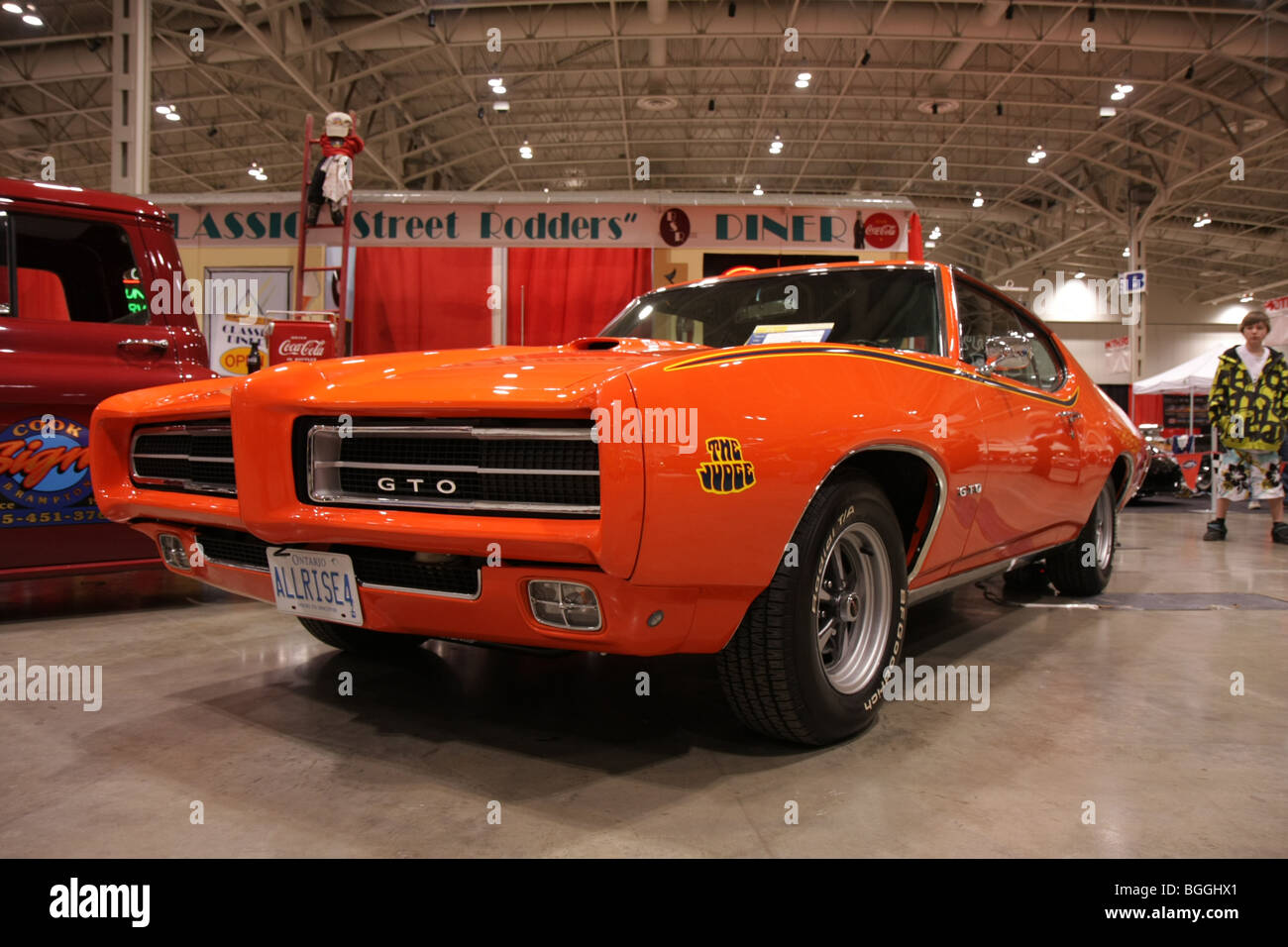 Orange custom vintage classic American retro sports cars on display ...