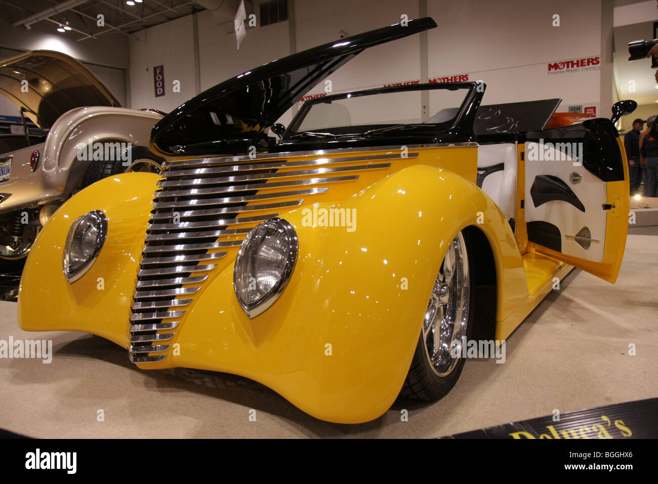 Yellow custom vintage classic American retro cars on display at a ...