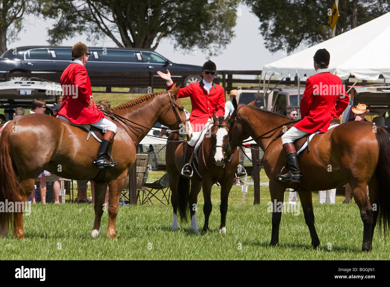 Steeplechase outriders in red coats assemble during the Foxfield Races, Charlottesville, VA, United States of America Stock Photo