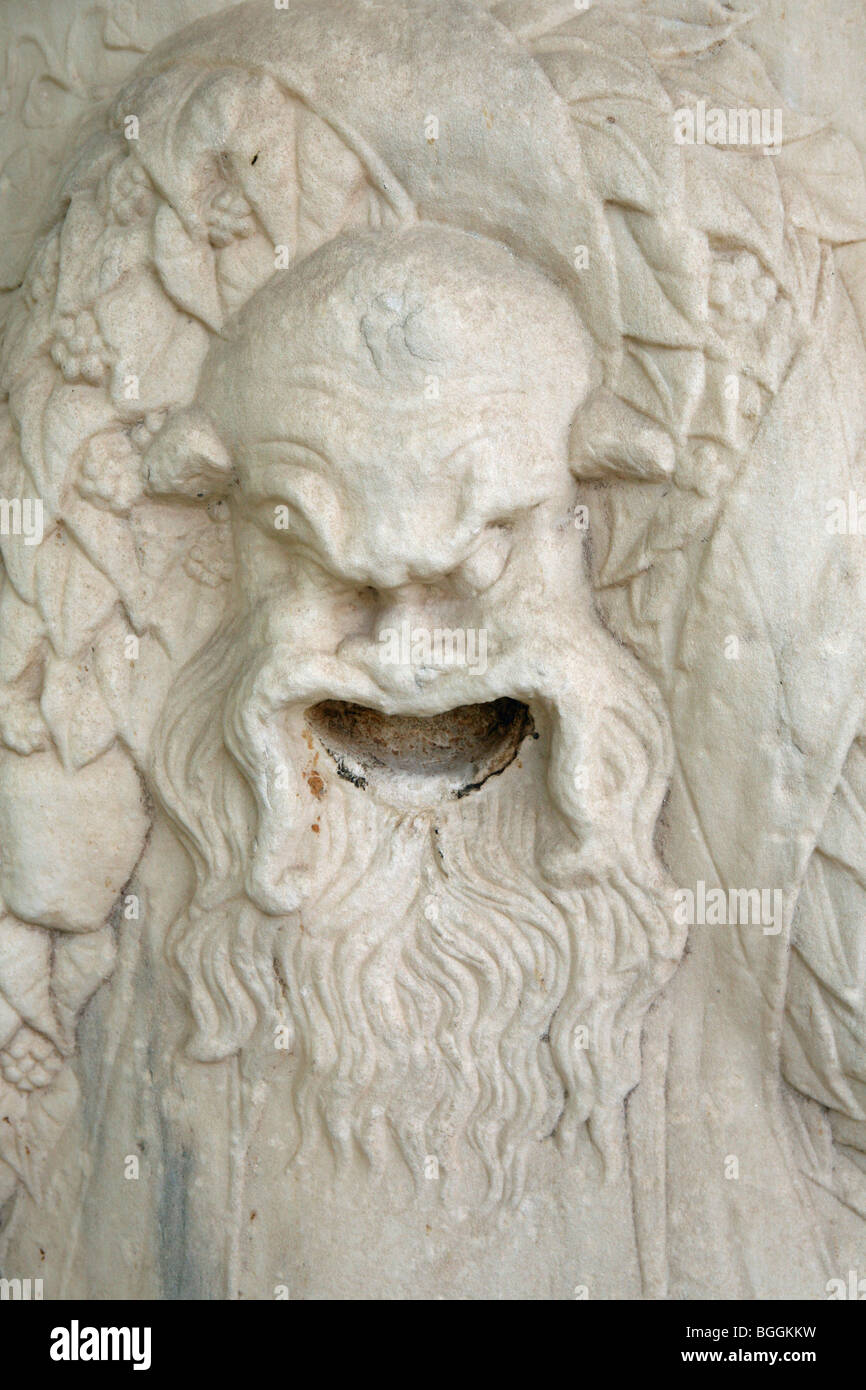 A carved satyr head beside the Acropolis Athens Greece - Stock Image