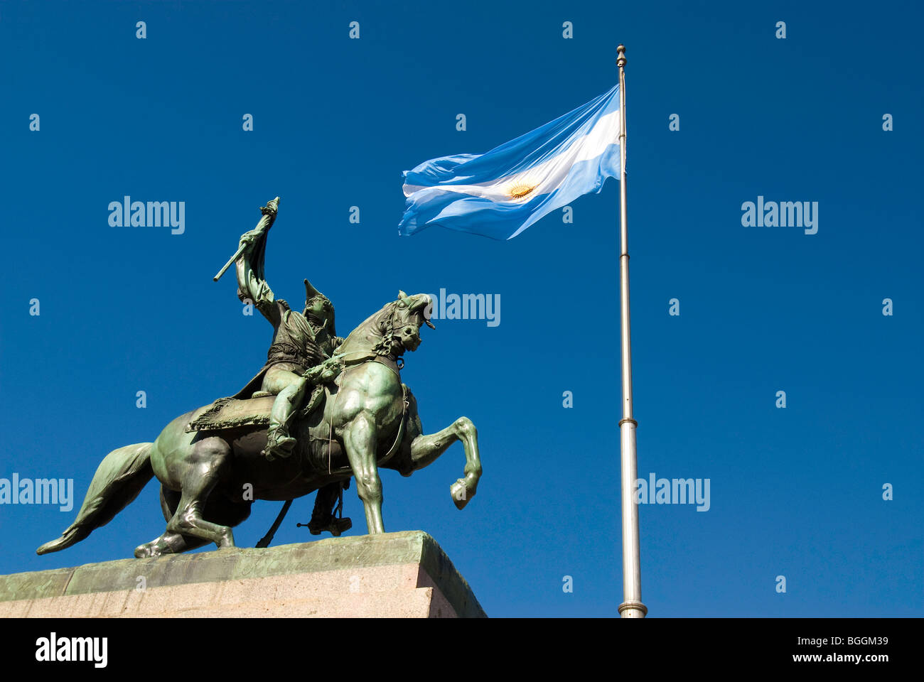 Statue of General Manuel Belgrano on his horse with the flag in Plaza de Mayor in Buenos Aires, Argentina - Stock Image