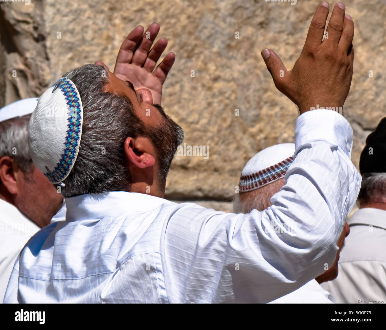 Religious Jewish man praying at the Wailing wall in Jerusalem the most holy site - Stock Image