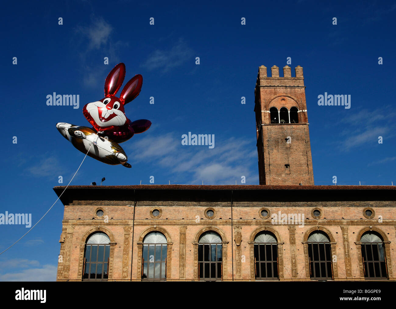 Balloons of cartoon rabbits fly in front of Palzzo re Enzo in the main square Piazza Maggiore in Bologna Emilia Stock Photo