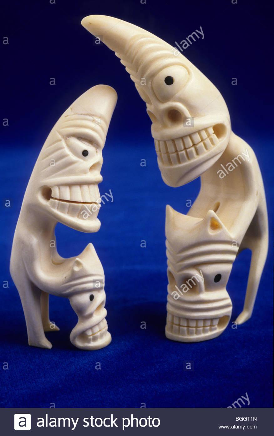 Alaska. Figurines carved from ivory walrus tusks. - Stock Image