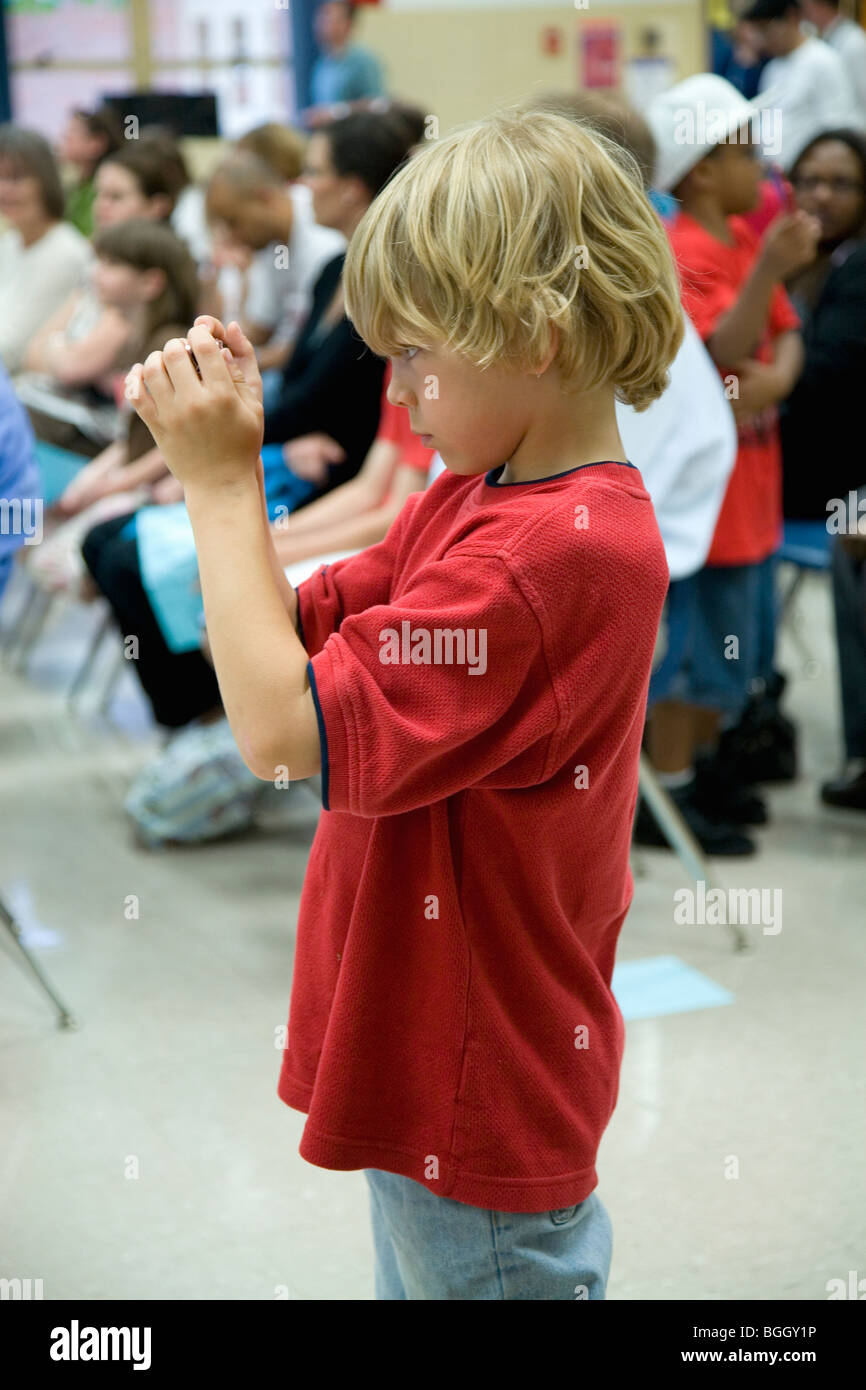 Blond haired boy in red t-shirt takes picture with digital camera at Ravensworth Elementary, Fairfax County, Springfield, - Stock Image