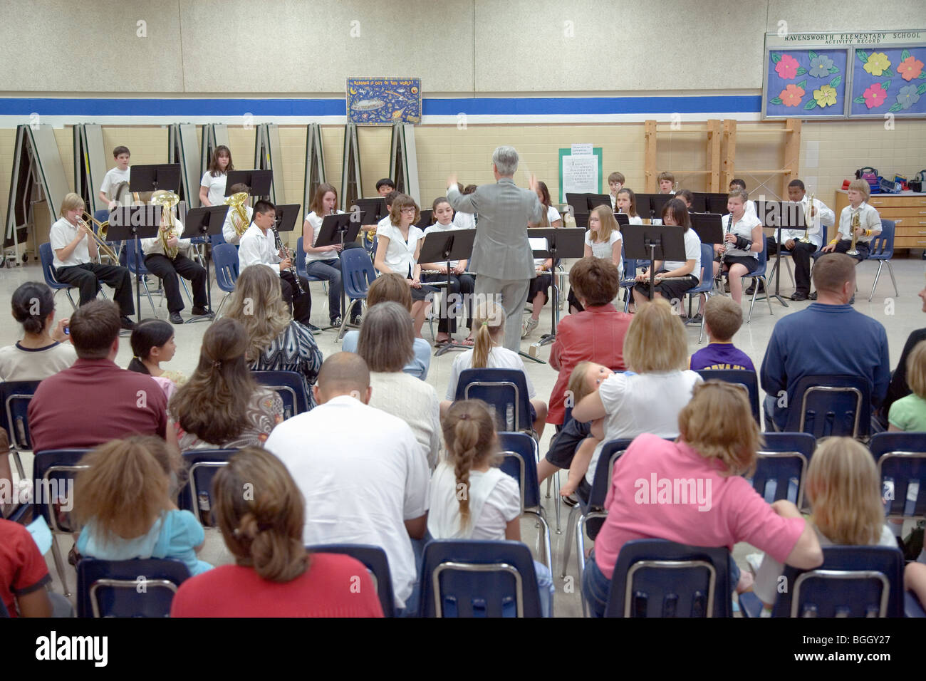 Parents and family watch 5th grade band recital at Ravensworth Elementary, Fairfax County, Springfield, Virginia - Stock Image