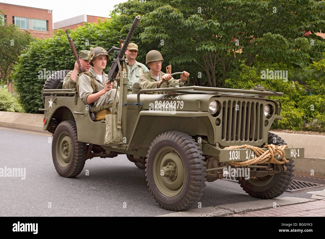 Reenactment of World War II Jeep and infantrymen driving in 1940s