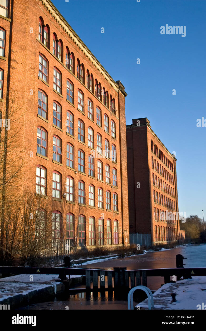 Victoria Mills (1867  + 1873) and Rochdale Canal, Miles Platting, Manchester, UK. Now residential, business and - Stock Image