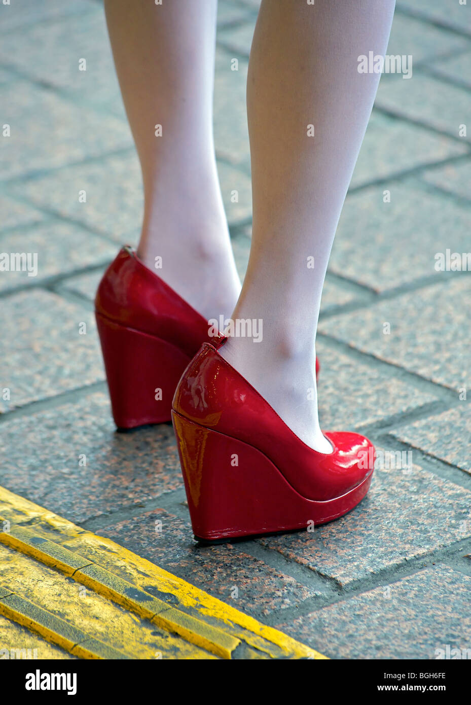 d19e2c6cb2c Bright red platform heels and white tights