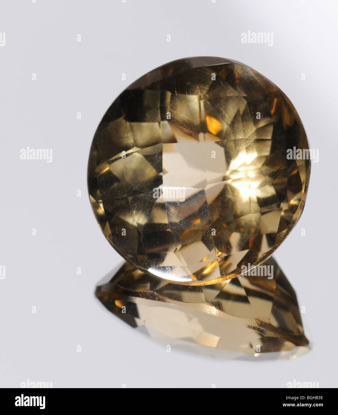 Chequerboard-cut Smoky Quartz gemstone and reflection - Stock Image
