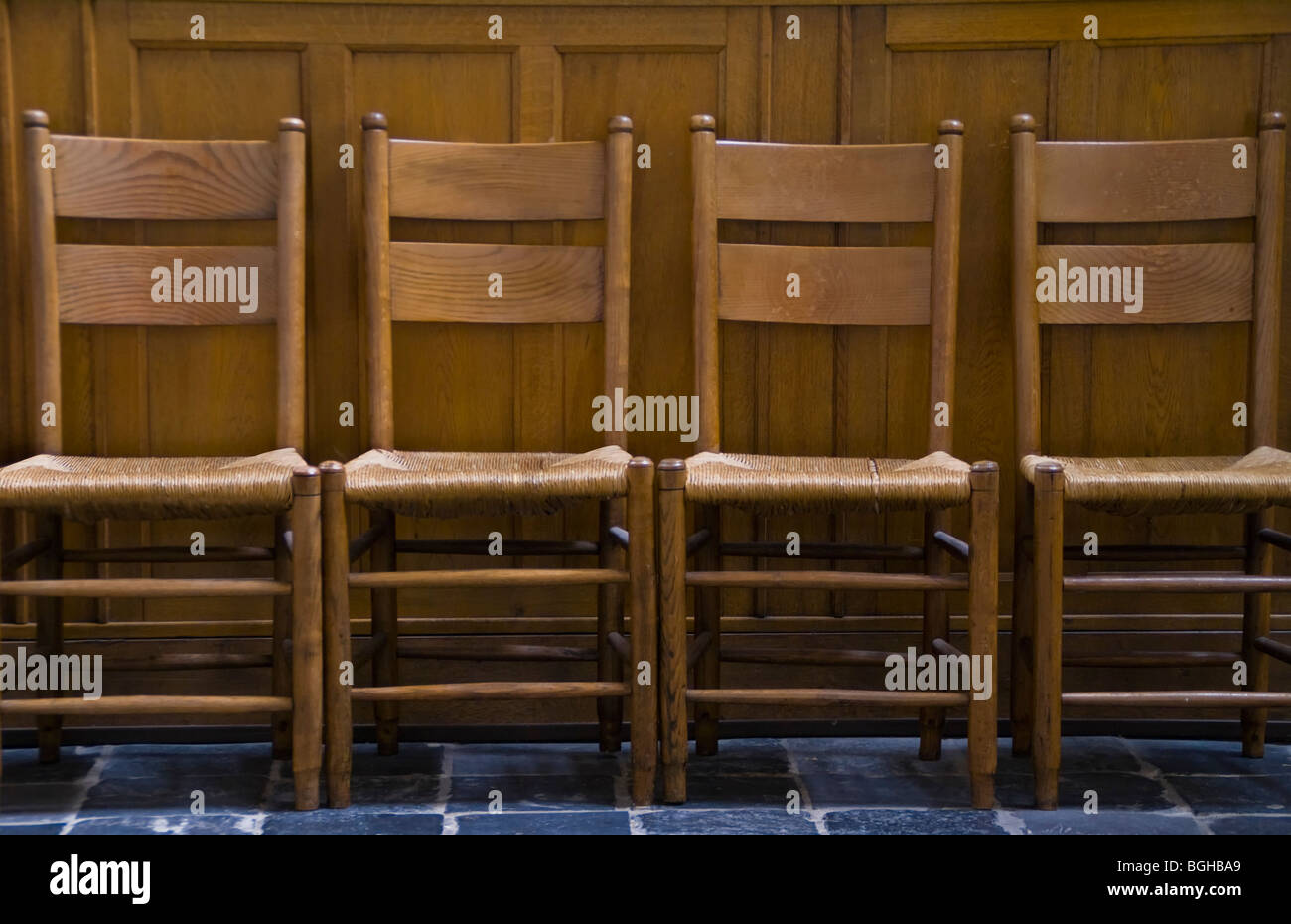 Four chairs in line at church - Stock Image