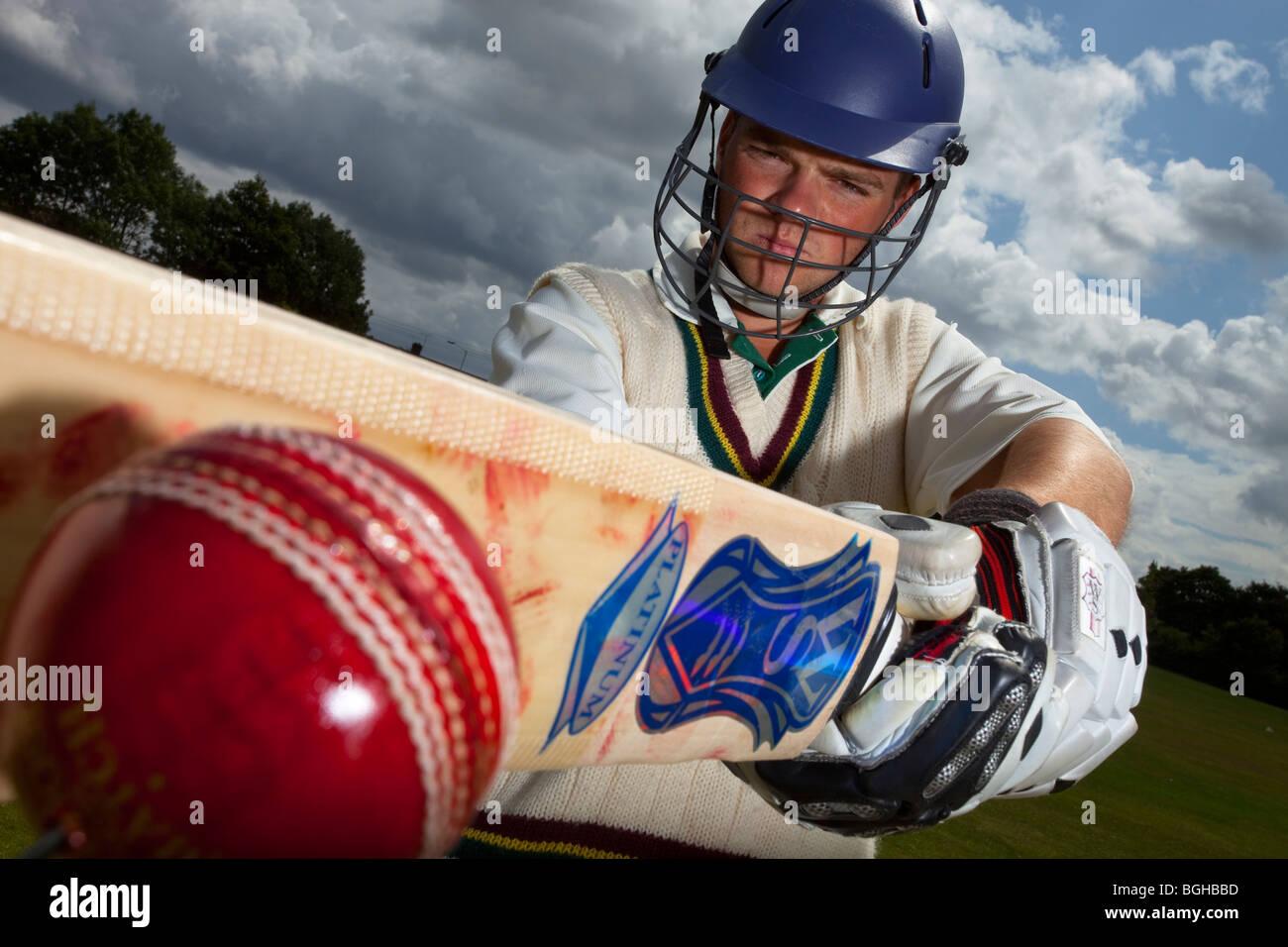 cricket player batsman ball bat - Stock Image