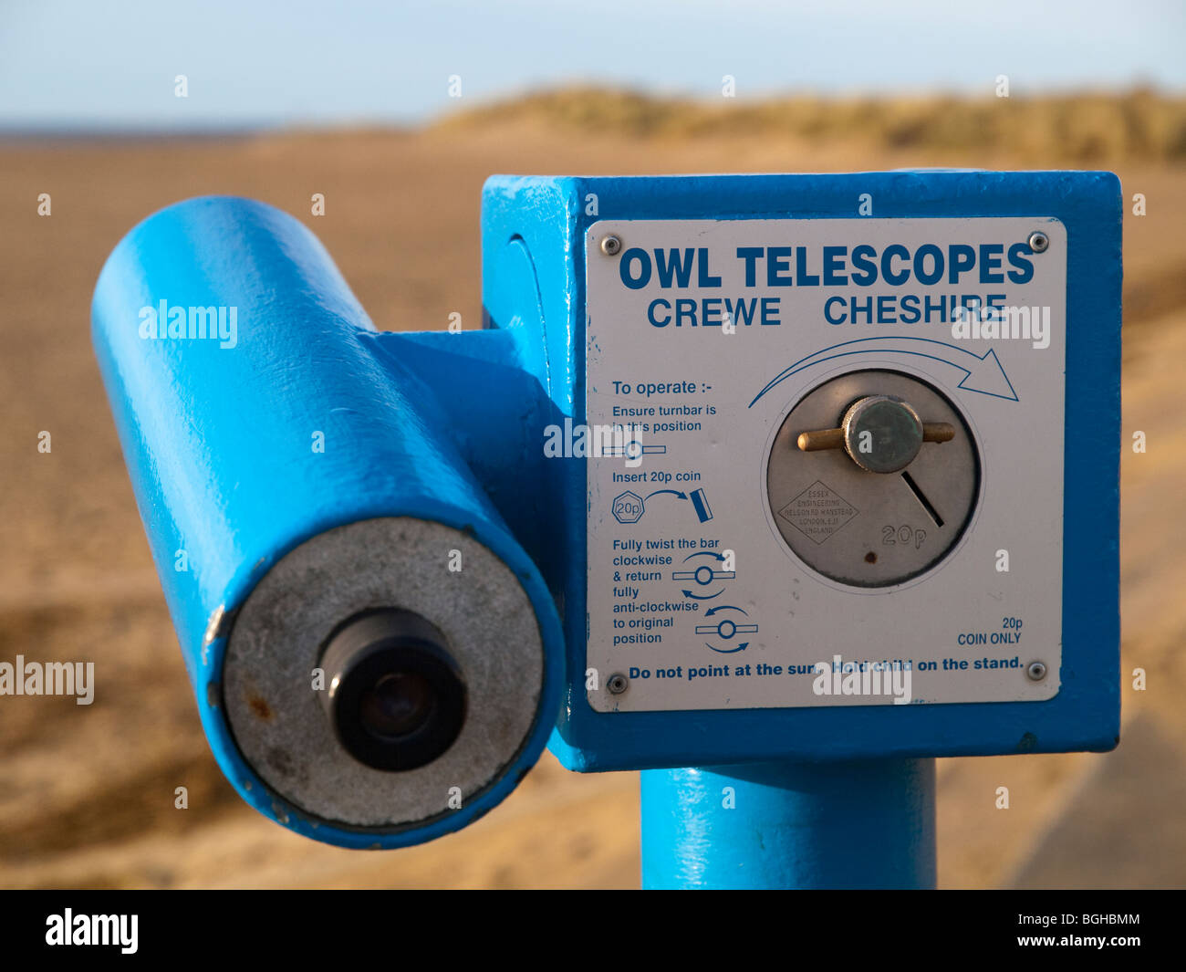 A coin operated telescope on the beach in Aberdovey (Aberdyfi), Gwynedd Mid Wales UK - Stock Image