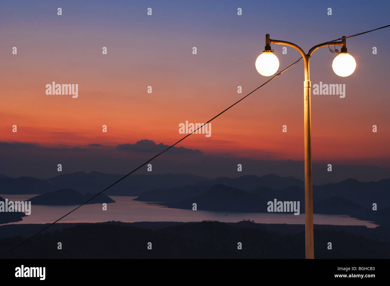 Streetlamp and Sunset from Mount Tapyas; Coron Town; Busuanga Island; Philippines - Stock Image