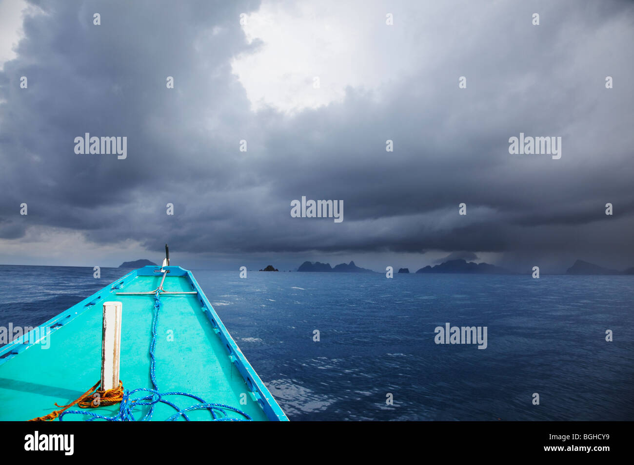 Banca boat heading into stormy weather; Palawan; Philippines. - Stock Image