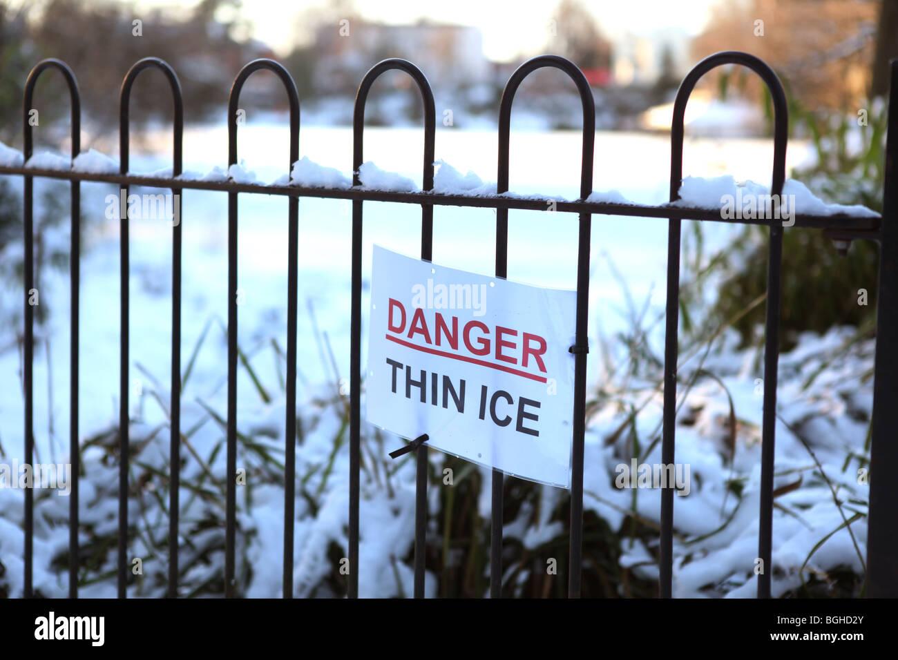 ice,danger,frozen pool,danger thin ice.winter,2010 - Stock Image