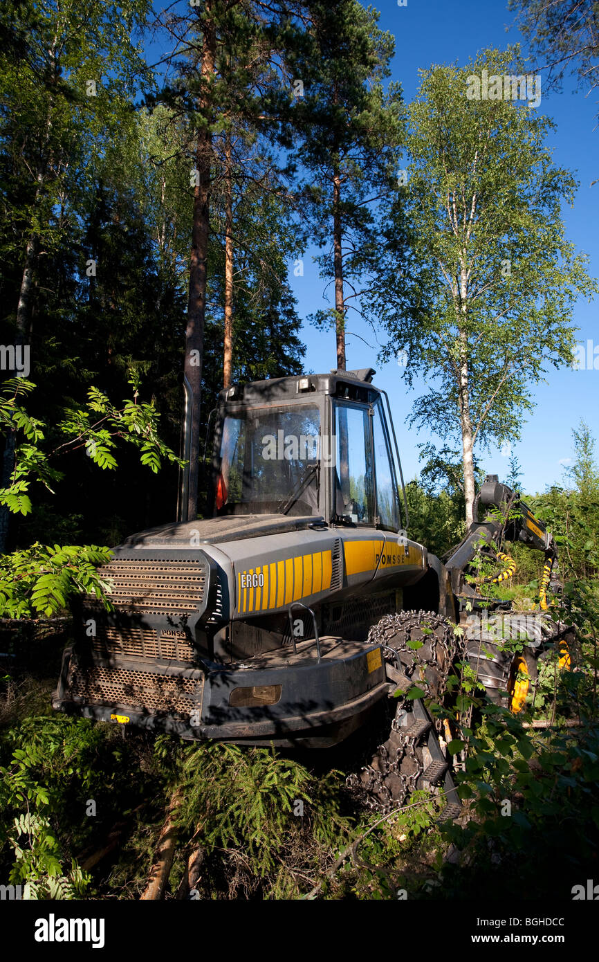 Yellow Ponsse Ergo forest harvester at felling site in Finnish forest - Stock Image