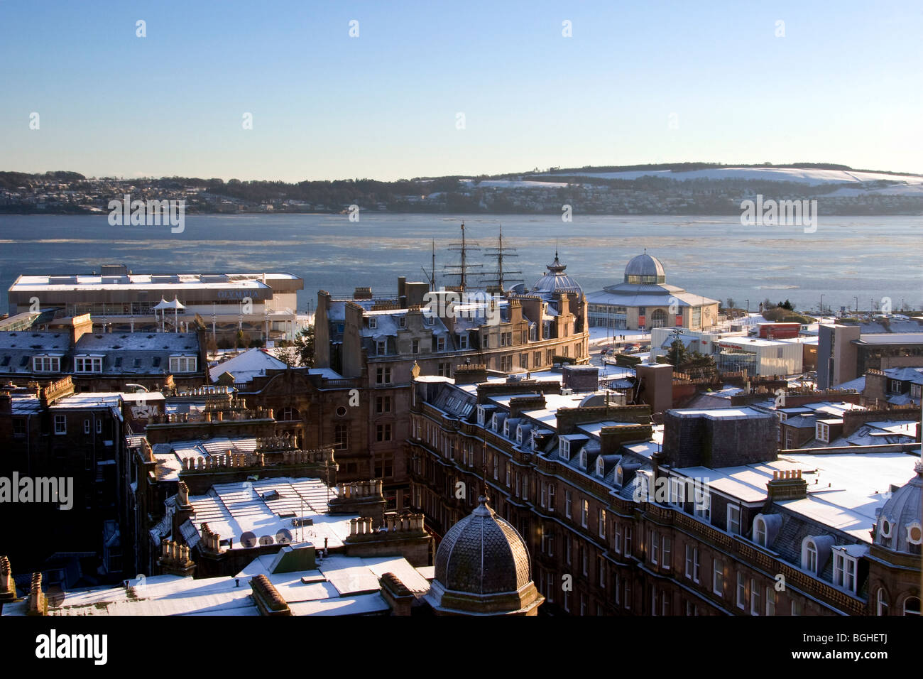 Aerial view of snow covered rooftops with a very rare scene of Ice and Snow covering the River Tay in Dundee,UK Stock Photo