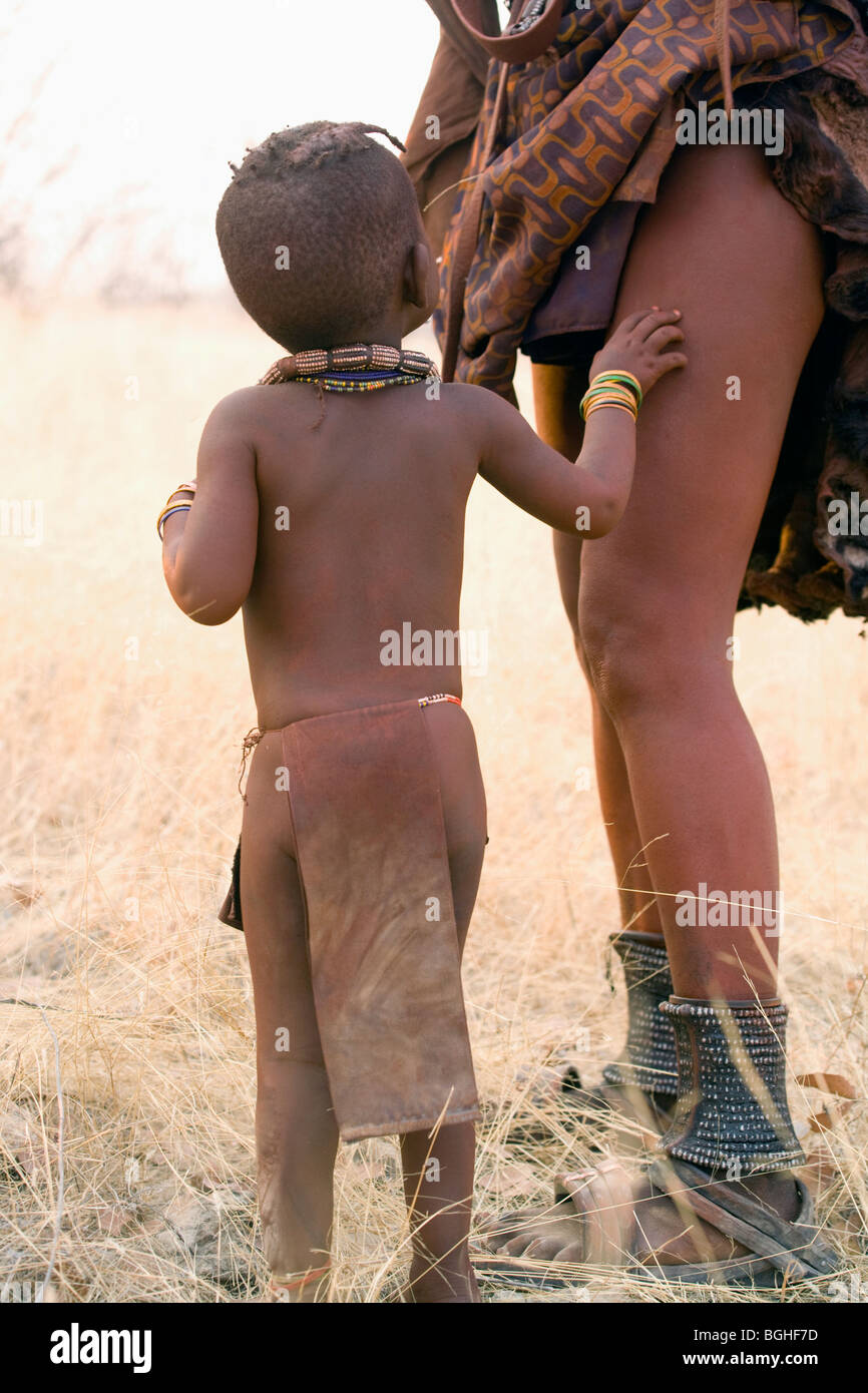 Himba child and mother, Opuwo, Namibia - Stock Image