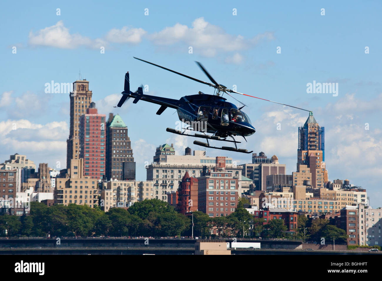 Tourists in on a Helicopter Ride in Manhattan, New York City - Stock Image