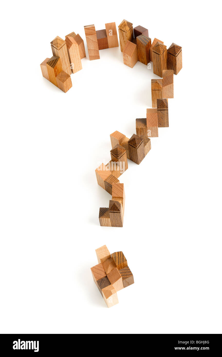 Wooden puzzle in the form of question mark on white background. Stock Photo