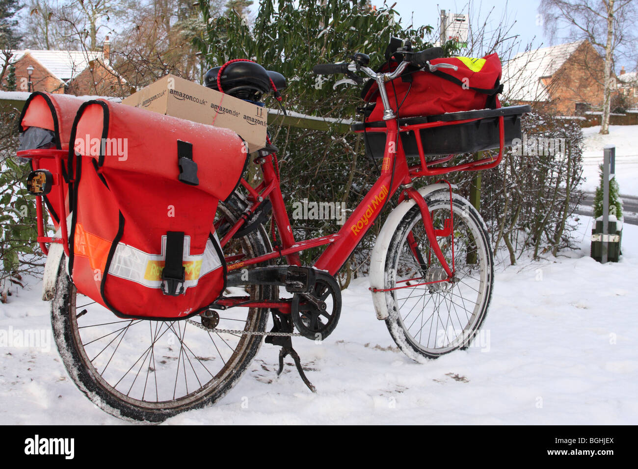 A Royal Mail bicycle in an English village in winter. - Stock Image