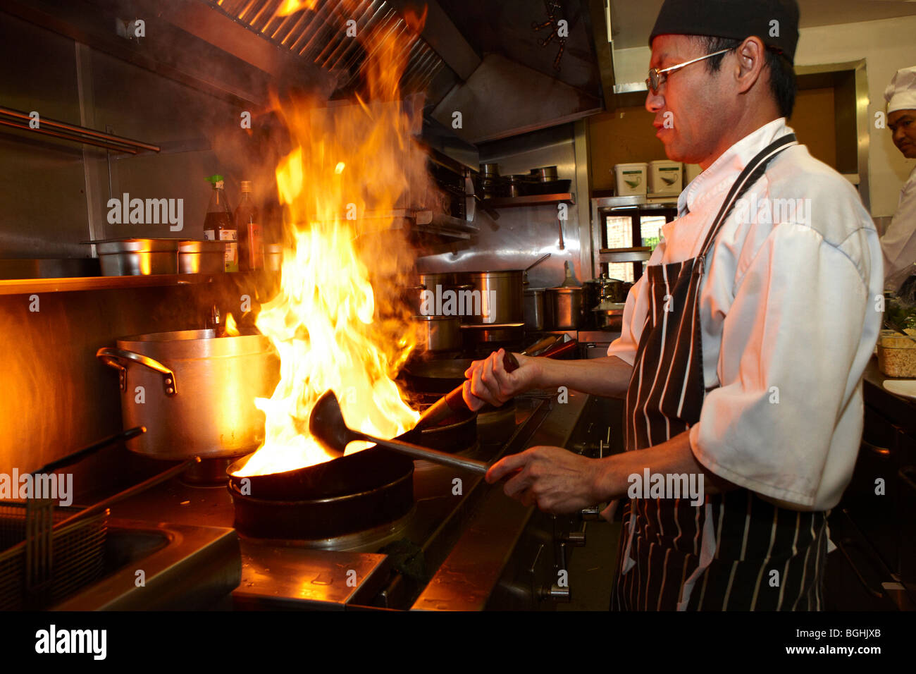 Asian chef cooking in restaurant kitchen