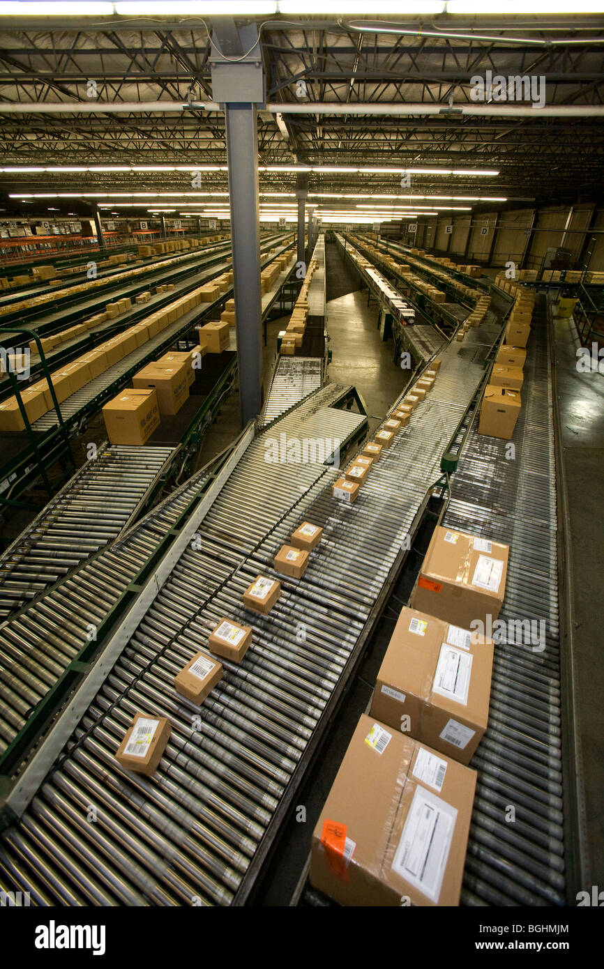 Boxes move along conveyor lines at a Walmart Stores Inc. Distribution Center in Arkansas. - Stock Image