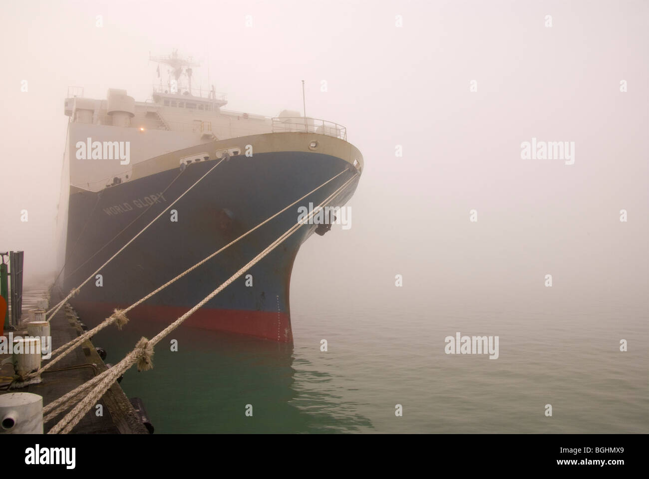 A car ship in port on a foggy day - Stock Image