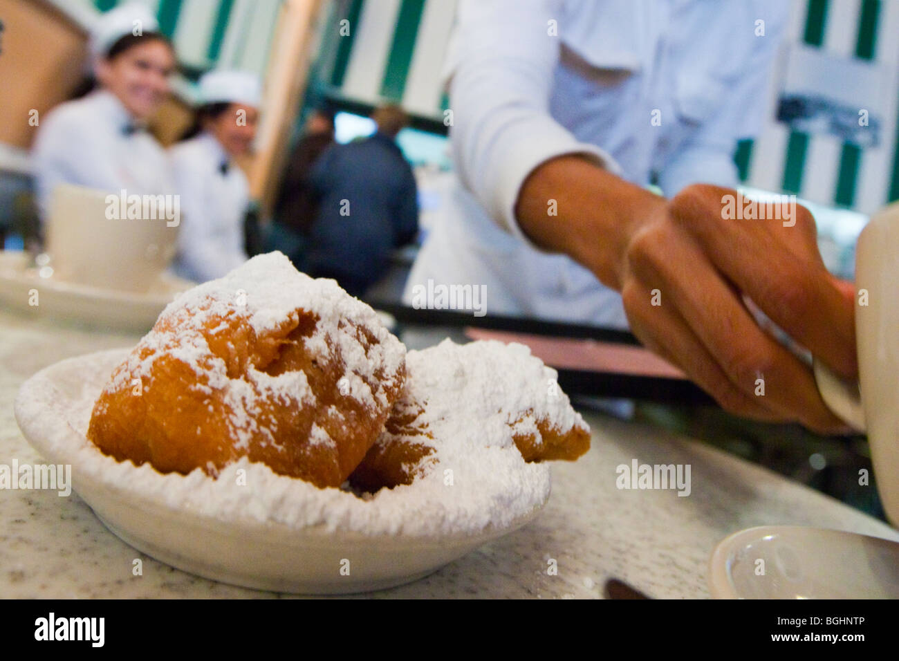 Beignets at Cafe Du Monde in the French Quarter of New Orleans, Louisiana - Stock Image