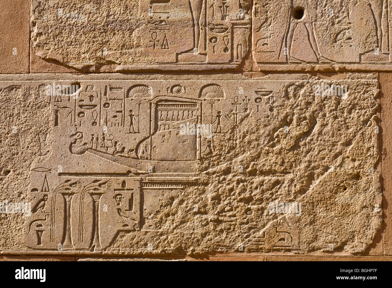 Carved relief of royal barque and fan bearers in the Red Chapel of Queen Hatshepsut in the open-air museum at Karnak - Stock Image