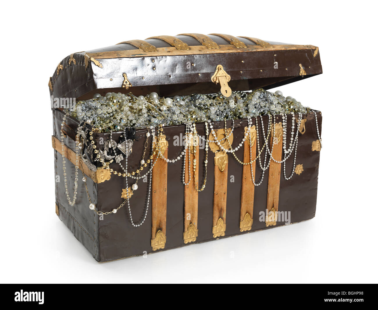 Treasure chest full of jewels and gold. Isolated on white background. - Stock Image