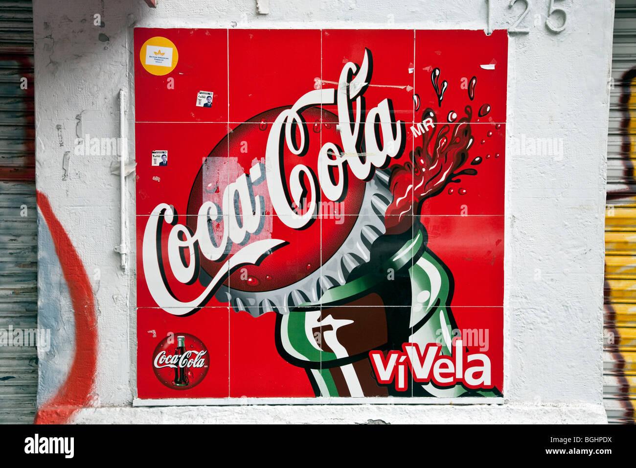 brightly colored old tile retro Coca Cola sign logo