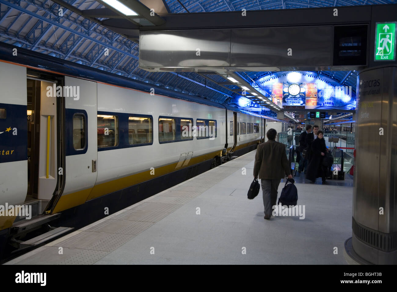 Passengers boarding the Eurostar train at #12;London St Pancras station. - Stock Image
