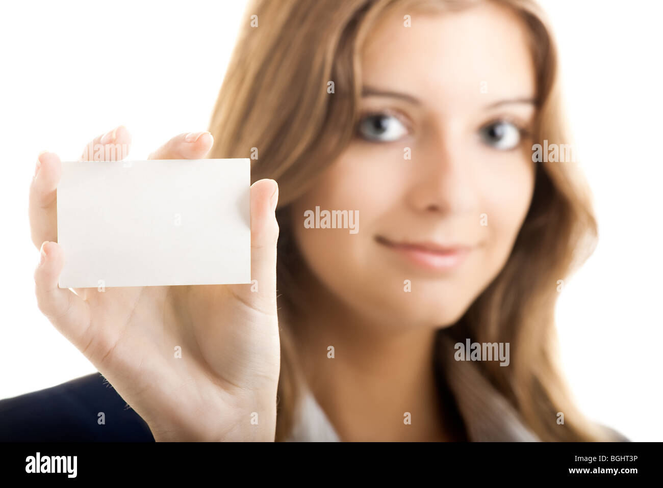 beautiful business woman holding a blank notecard - Focus is on the card - Stock Image