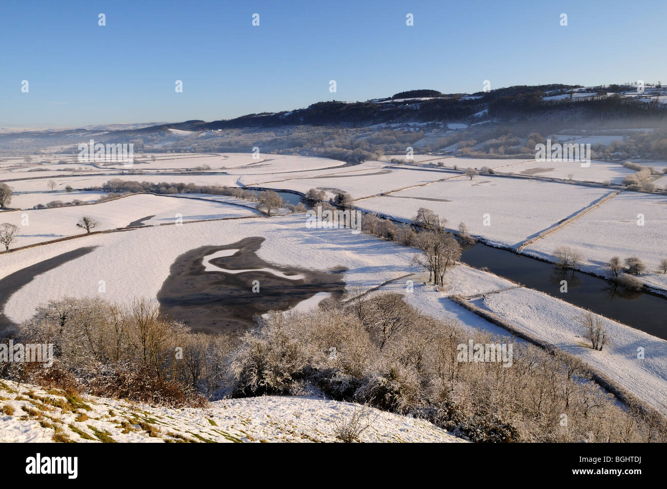 Frozen oxbow lake in the Tywi Valley towards Carmarthen Fans Carmarthenshire Wales Cymru UK GB - Stock Image