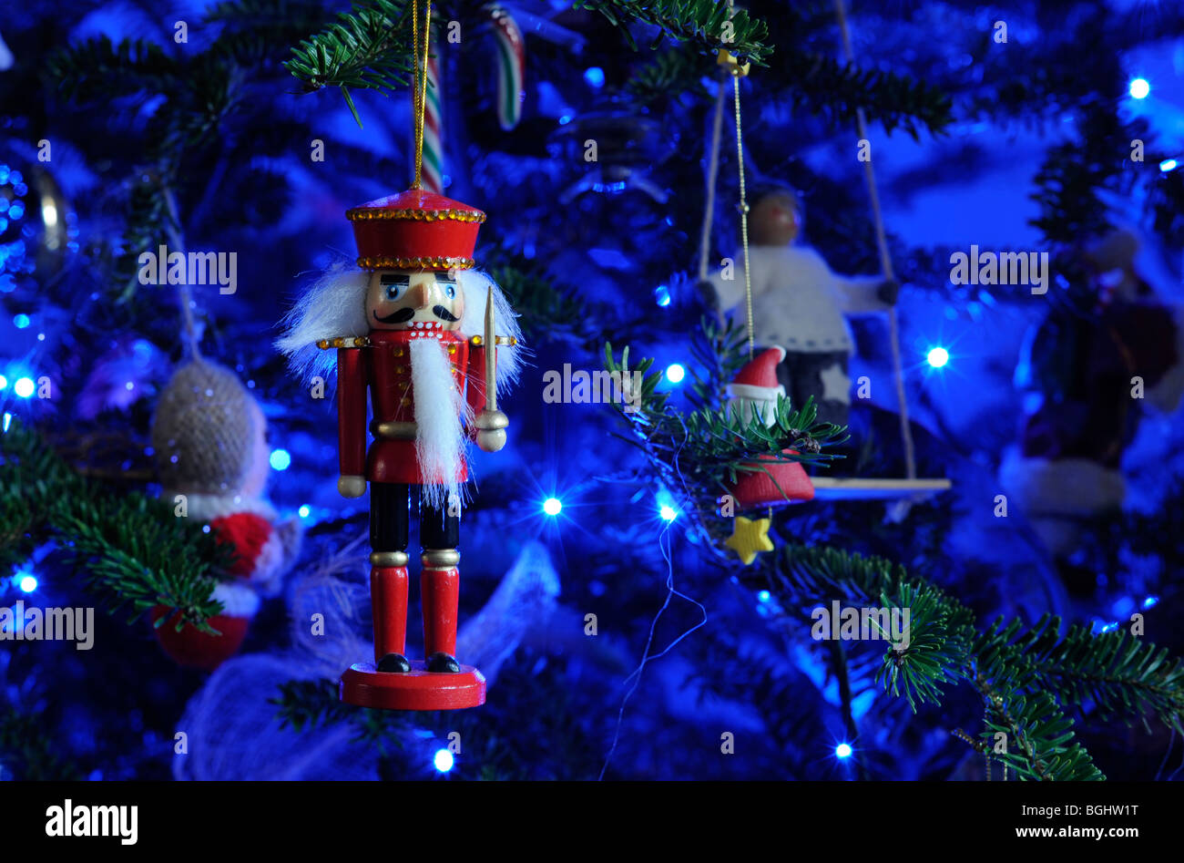 a traditional wooden nutcracker soldier christmas tree decoration with sword hangs from a festive tree with - Christmas Decorations Wooden Soldiers