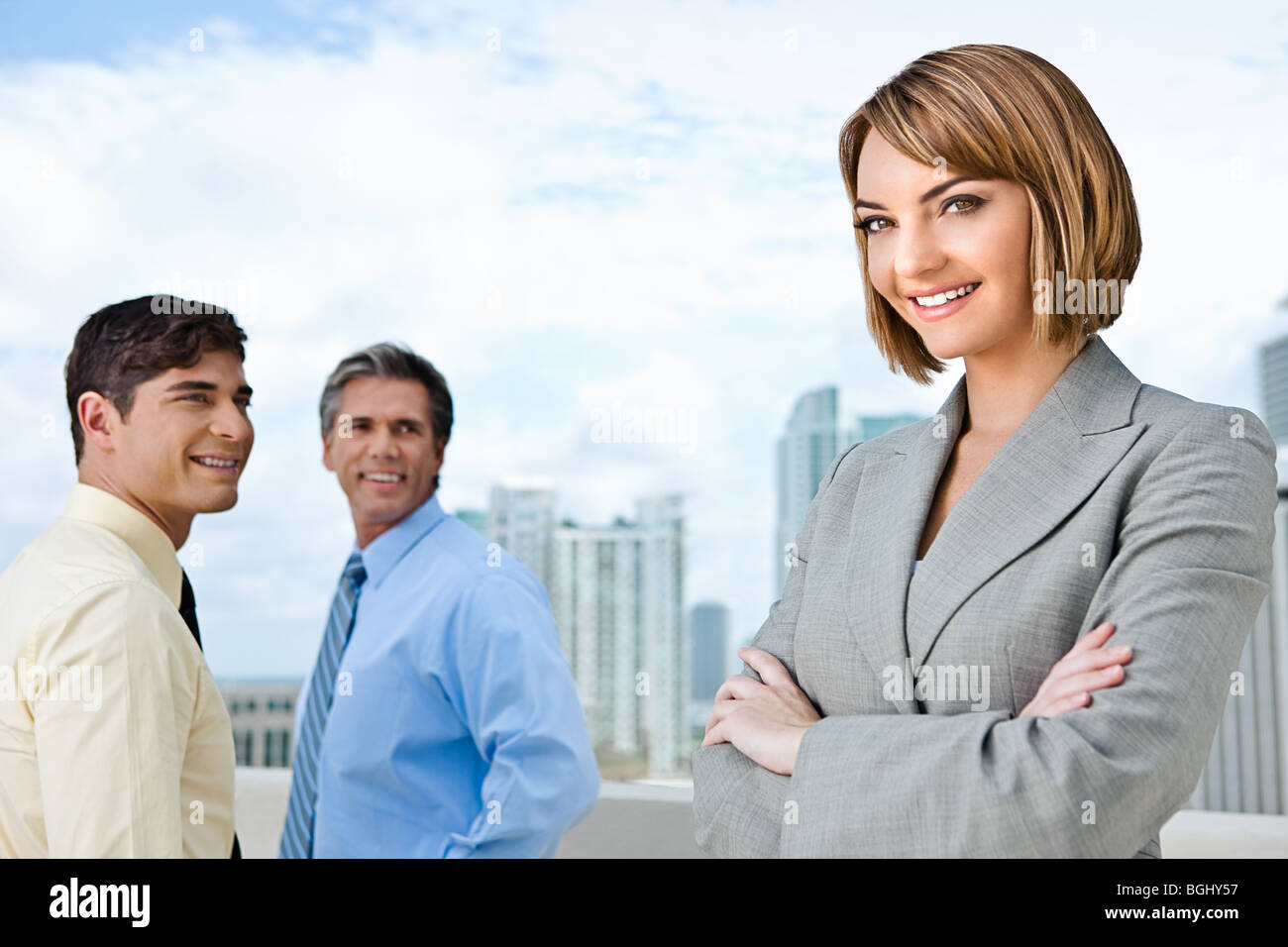 Businesswoman and her two male subordinates. - Stock Image