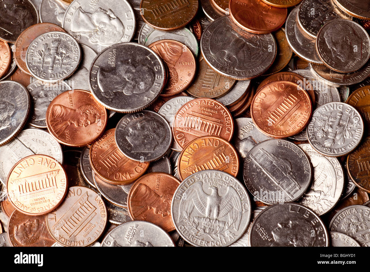 pennies, nickles, dimes, and quarters macro background - Stock Image